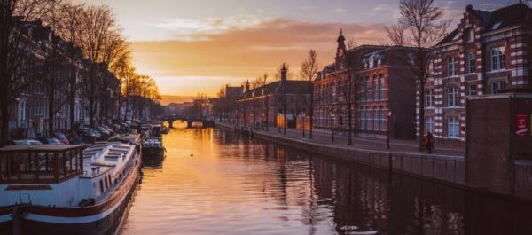 Beautiful sunrise over Amsterdam Canal ATO Tours Tailor made tours